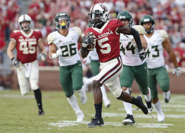 FILE - In this Sept. 29, 2018, file photo, Oklahoma wide receiver Marquise Brown (5) runs ahead of Baylor in the second half of an NCAA college football game in Norman, Okla. Oklahoma quarterback Kyler Murray has star receivers in Brown and CeeDee Lamb, yet he doesnt hesitate to throw to other options. (AP Photo/Alonzo Adams, File)