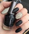 "<p>If you aren't one to shy away from edgy looks, a spiky <a href=""https://www.goodhousekeeping.com/beauty/nails/a33898/accent-nail-art-design-ideas/"" rel=""nofollow noopener"" target=""_blank"" data-ylk=""slk:accent"" class=""link rapid-noclick-resp"">accent</a> right in the middle of black matte nails looks <em>so</em> cool — and it's totally unexpected.</p><p><a class=""link rapid-noclick-resp"" href=""https://www.amazon.com/OPI-Nail-Lacquer-Coat-Matte/dp/B0001435D4/ref=sr_1_1_s_it?tag=syn-yahoo-20&ascsubtag=%5Bartid%7C10055.g.1421%5Bsrc%7Cyahoo-us"" rel=""nofollow noopener"" target=""_blank"" data-ylk=""slk:SHOP MATTE TOP COAT"">SHOP MATTE TOP COAT</a></p><p><em><a href=""https://www.instagram.com/thedailynail/"" rel=""nofollow noopener"" target=""_blank"" data-ylk=""slk:See more at The Daily Nail »"" class=""link rapid-noclick-resp"">See more at The Daily Nail »</a></em><br></p>"
