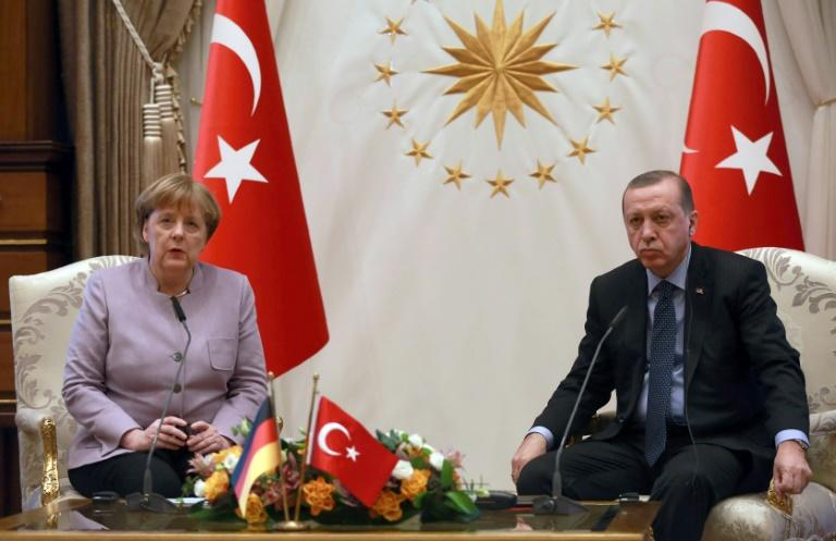 Turkish President Recep Tayyip Erdogan (R) listens on as German Chancellor Angela Merkel speaks during their meeting at the Presidential Palace in Ankara on February 2, 2017