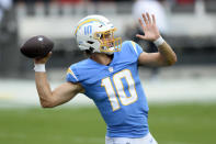 Los Angeles Chargers quarterback Justin Herbert (10) throws a pass before an NFL football game against the Tampa Bay Buccaneers Sunday, Oct. 4, 2020, in Tampa, Fla. (AP Photo/Jason Behnken)