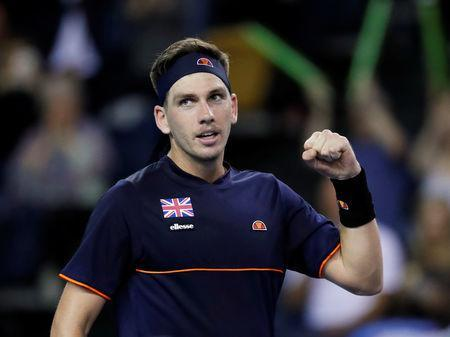 FILE PHOTO: Tennis - Davis Cup - World Group Play Off - Great Britain v Uzbekistan - Emirates Arena, Glasgow, Britain - September 16, 2018 Britain's Cameron Norrie celebrates winning his match against Uzbekistan's Sanjar Fayziev REUTERS/Russell Cheyne