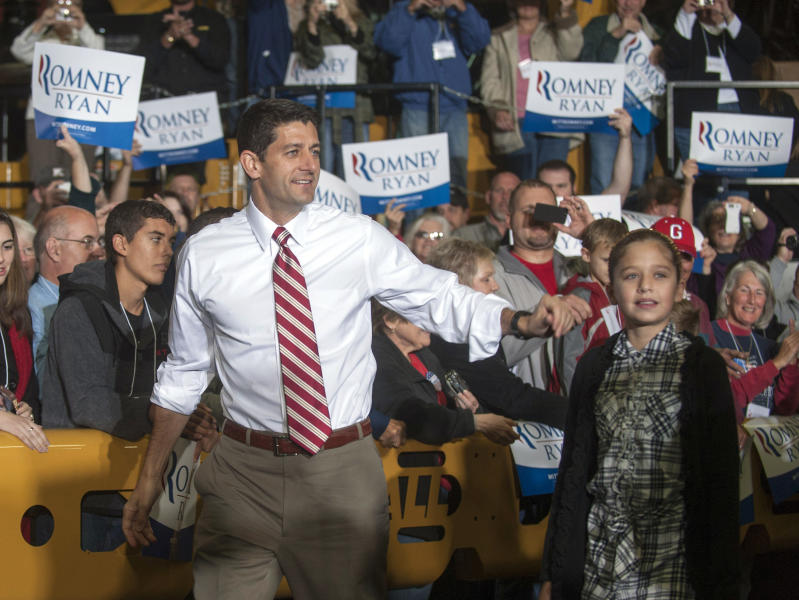 Republican vice presidential candidate Rep. Paul Ryan, R-Wis., greets the crowd with his daughter Liza, before a campaign rally at the Gradall Industries plant in New Philadelphia, Ohio, Saturday, Oct. 27, 2012. AP Photo/Phil Long)