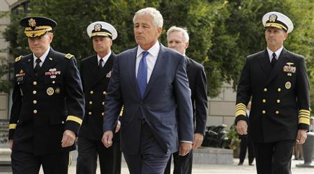 Military leaders arrive at a ceremony, honoring the victims of an attack at the Navy Yard, at the Navy Memorial in Washington