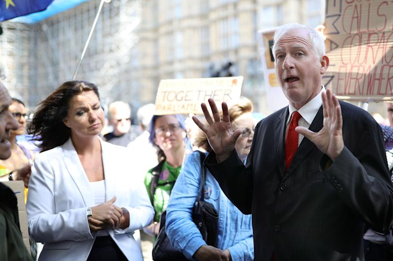 MP Heidi Allen (left) and Labour Party MP Daniel Zeichner speak to Brexit protesters outside the Houses of Parliament in Westminster, London.