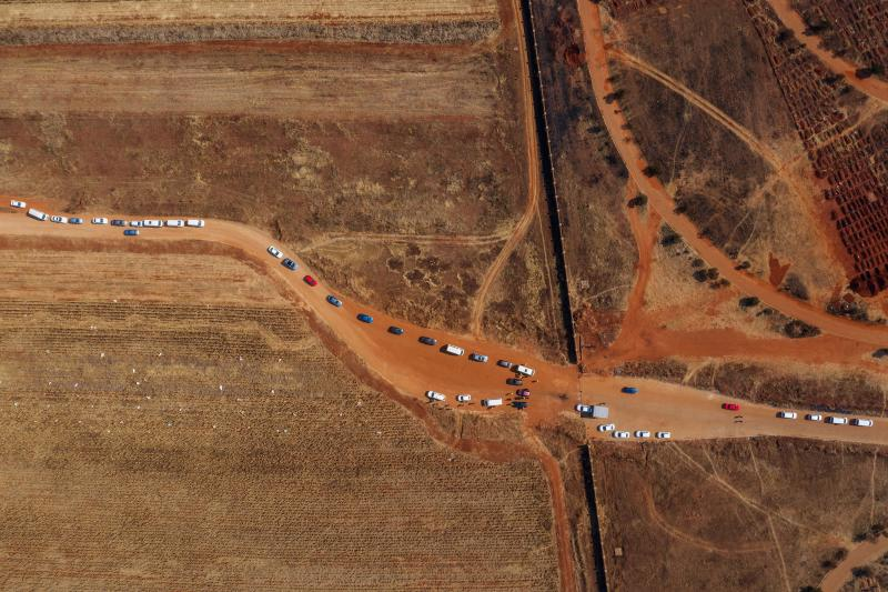 This aerial picture shows funeral processions queueing at the entrance of the Olifantsvlei Cemetery in Soweto, on July 23. Source: AFP