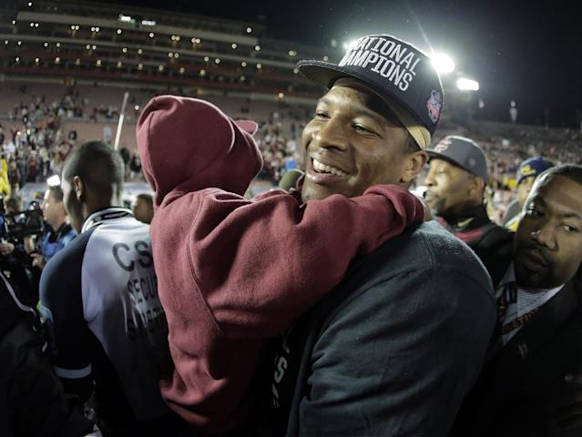Florida State's Jameis Winston with his brother Jonah after the NCAA BCS National Championship college football game against Auburn Monday, Jan. 6, 2014, in Pasadena, Calif. Florida State won 34-31. (AP Photo/Chris Carlson)