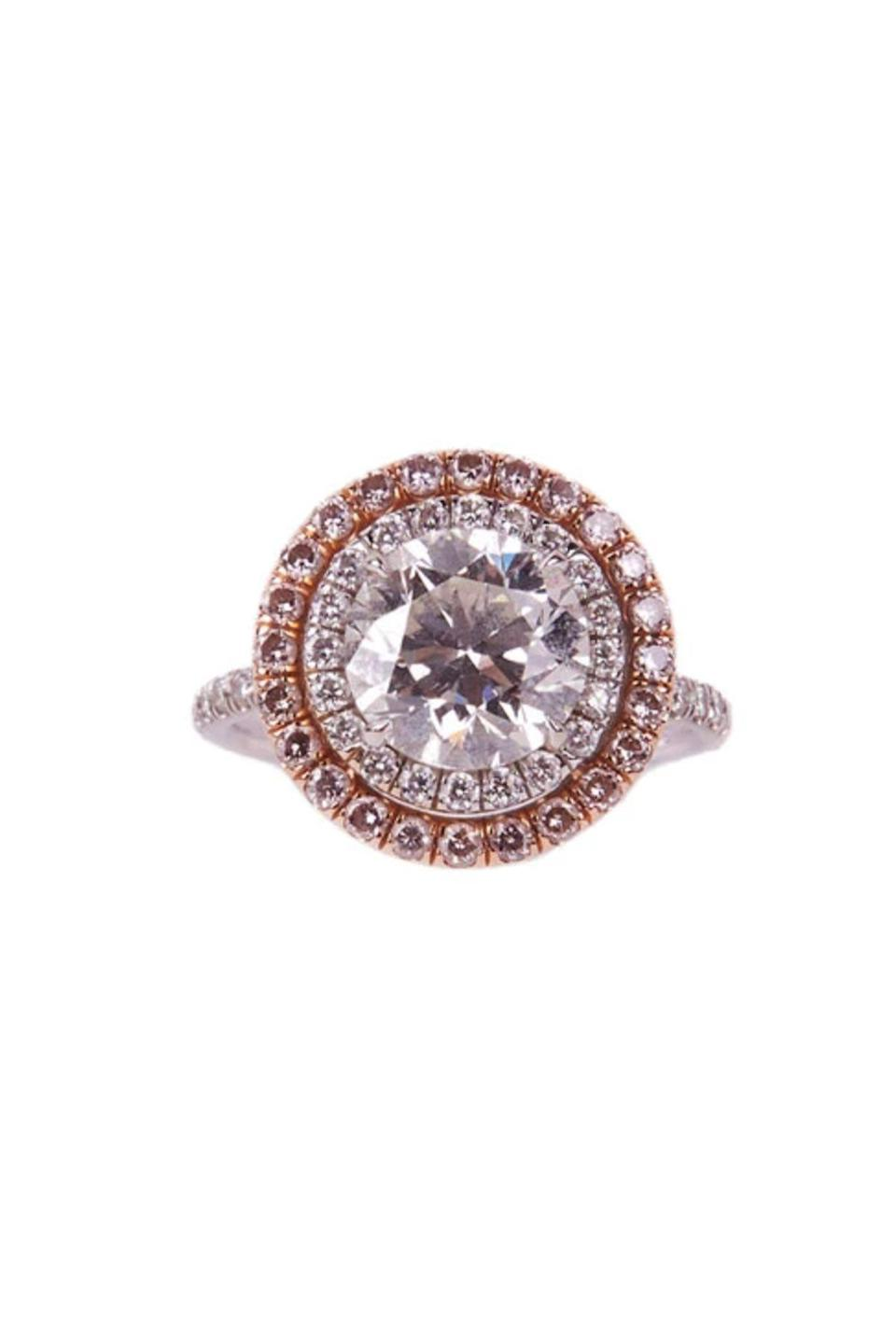 """<p><strong>María José</strong></p><p>mariajosejewelry.com</p><p><strong>$45000.00</strong></p><p><a href=""""https://mariajosejewelry.com/collections/diamonds/products/diamond-double-halo-ring"""" rel=""""nofollow noopener"""" target=""""_blank"""" data-ylk=""""slk:Shop Now"""" class=""""link rapid-noclick-resp"""">Shop Now</a></p><p>White diamonds are the classic choice for engagement rings, but a double halo of pink diamonds feels extra special. </p>"""