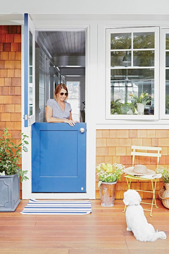 """<p><strong>Pictured:</strong> LauraLee and Bill share their cedar-shingle cottage with their bichon frise, Lucy. The door is painted <a href=""""http://www.prattandlambert.com/"""" target=""""_blank"""">Noir by Pratt & Lambert</a>.</p> <p><strong>Q&A with Homeowers and Designers </strong><strong>LauraLee and Bill Symes</strong></p> <p><strong>CL:</strong> It seems pretty dreamy to live in a house that floats. What's the catch?</p> <p><strong>LauraLee Symes:</strong> Well, the most surprising perk is that you become an integral part of the environment and of the river itself. We're constantly surrounded by beautiful wildlife; there are a couple of families of bald eagles that live behind our house, and otters regularly swim up to our docks. It's the cutest thing. But you asked about the catch: The difficult part is when they decide to move in. We've had Canada geese laying eggs, and otters hanging around and eating shellfish on our dock. That can smell a little!</p>"""