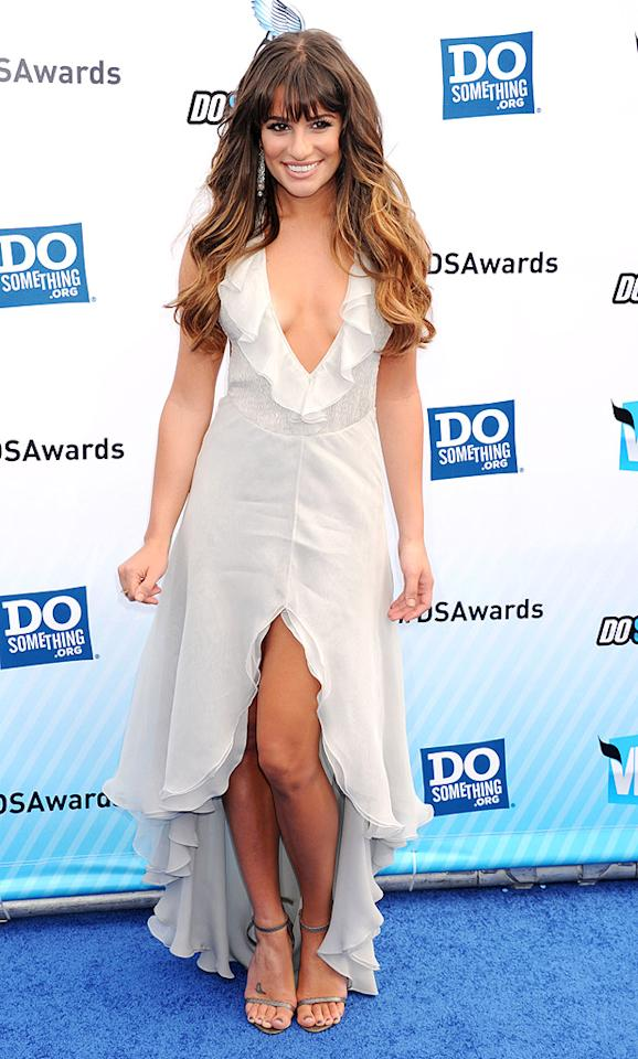 "On Sunday evening, Lea Michele looked sexier than ever upon arriving at the star-studded 2012 Do Something Awards in Santa Monica, California. The <a target=""_blank"" href=""http://omg.yahoo.com/news/first-pic-kate-hudson-bonds-lea-michele-glee-124500557.html"">""Glee""</a> actress -- who decided to show off both her decolletage and toned stems -- sauntered down the blue carpet in a breathtaking, Giorgio Armani-designed dress, which featured an off-white hue, plunging neckline, and ruffle-enhanced hem. Lea's lovely accessories included metallic Jenni Kayne sandals and statement earrings courtesy of Samira 13. (8/19/2012)"