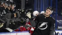 Tampa Bay Lightning left wing Ross Colton (79) celebrates with the bench after his goal against the Detroit Red Wings during the first period of an NHL hockey game Saturday, April 3, 2021, in Tampa, Fla. (AP Photo/Chris O'Meara)