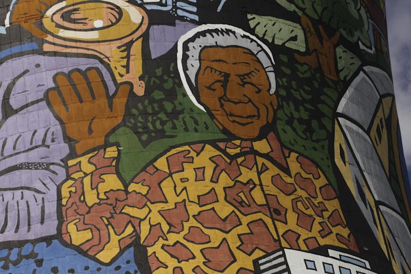 A giant portrait of former president Nelson Mandela adorns a cooling tower of a now defunct power station in Soweto, South Africa, Monday, Dec 10, 2012. Mandela underwent more unspecified medical tests in a military hospital in Pretoria, South Africa, as the public and journalists outside continued to ask the same, as of yet unanswered questions: What, if anything, is wrong with the 94-year-old anti-apartheid icon. (AP Photo/Denis Farrell)