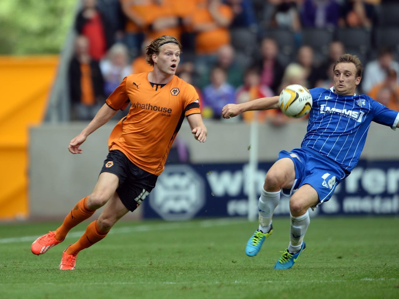 Bjorn Siguardarson Wolves & Charlie Lee Gillingham during the Sky Bet League One match at the Molineaux, Wolverhampton.