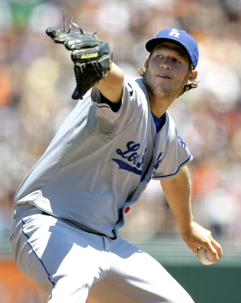 Los Angeles Dodgers starting pitcher Clayton Kershaw throws against the San Francisco Giants during the first inning of a baseball game, Wednesday, July 20, 2011,  in San Francisco. (AP Photo/Eric Risberg)