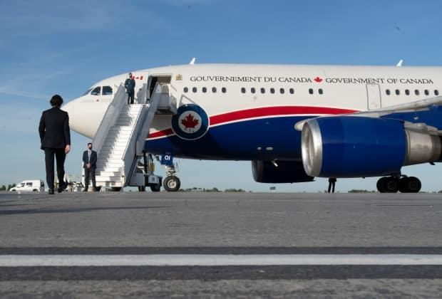 Prime Minister Justin Trudeau walks to a government plane at an airport in Ottawa, Thursday, June 10, 2021. Trudeau will participate in the G7 Summit in the United Kingdom and NATO meeting in Belgium. (Adrian Wyld/The Canadian Press - image credit)