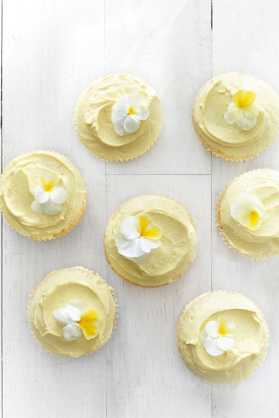 """<p>Edible flowers make even the simplest recipe (this buttermilk one, for example) much fancier. </p><p><em><a href=""""https://www.goodhousekeeping.com/food-recipes/a14645/buttermilk-cupcakes-recipe-clx0315/"""" rel=""""nofollow noopener"""" target=""""_blank"""" data-ylk=""""slk:Get the recipe for Buttermilk Cupcakes »"""" class=""""link rapid-noclick-resp"""">Get the recipe for Buttermilk Cupcakes »</a></em></p>"""