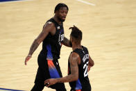 New York Knicks forward Julius Randle, left, reacts with forward Reggie Bullock, right, during the second half of an NBA basketball game against the New Orleans Pelicans on Sunday, April 18, 2021, in New York. (AP Photo/Adam Hunger, Pool)