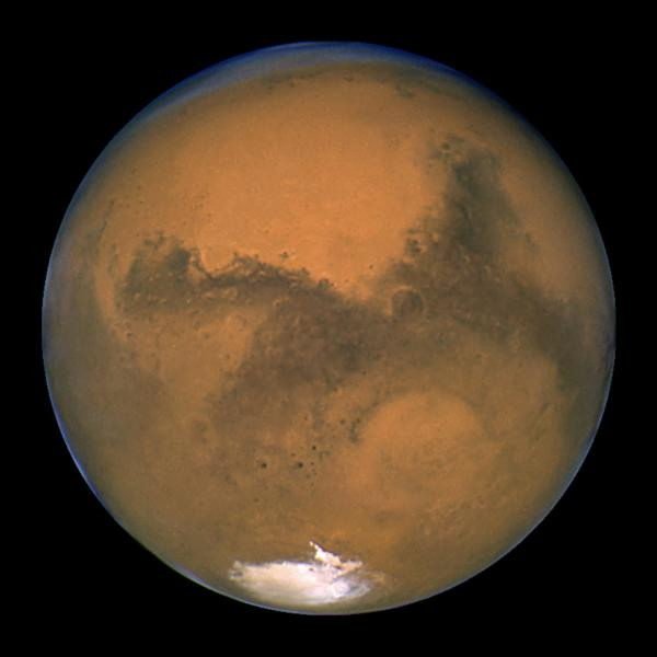 The planet Mars is seen in an image from NASA's Hubble Space Telescope taken August 27, 2003. Scientists have found the first evidence that briny water may flow on the surface of Mars during the planet's summer months, a paper published on Monday showed.  REUTERS/NASA/Handout via Reuters  THIS IMAGE HAS BEEN SUPPLIED BY A THIRD PARTY. IT IS DISTRIBUTED, EXACTLY AS RECEIVED BY REUTERS, AS A SERVICE TO CLIENTS. FOR EDITORIAL USE ONLY. NOT FOR SALE FOR MARKETING OR ADVERTISING CAMPAIGNS