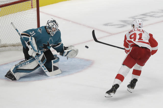 San Jose Sharks goaltender Martin Jones (31) defends a shot attempt by Detroit Red Wings center Frans Nielsen in the shootout of an NHL hockey game in San Jose, Calif., Saturday, Nov. 16, 2019. The Sharks won 4-3. (AP Photo/Jeff Chiu)