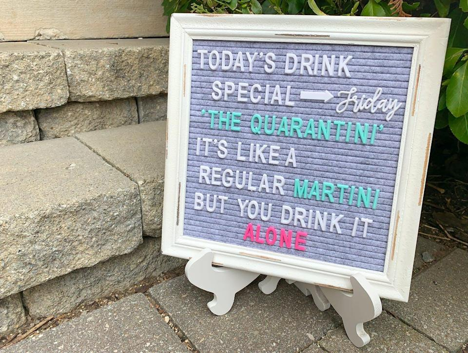 Sign that reads 'today's drink special is the quarantini, its like a regular martini but you drink it alone'
