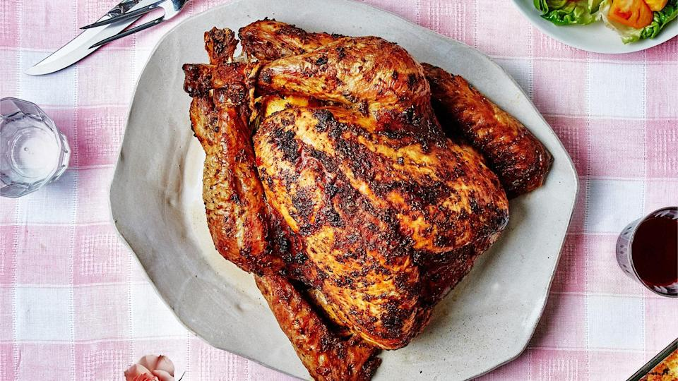 "Pavochon, a mash-up of pavo for turkey and chon for lechón, is the centerpiece of a Puerto Rican Thanksgiving. Note: Achiote paste is essential for getting a deep burnished color and extra rich flavor all over the turkey. <a href=""https://www.bonappetit.com/recipe/pavochon?mbid=synd_yahoo_rss"" rel=""nofollow noopener"" target=""_blank"" data-ylk=""slk:See recipe."" class=""link rapid-noclick-resp"">See recipe.</a>"