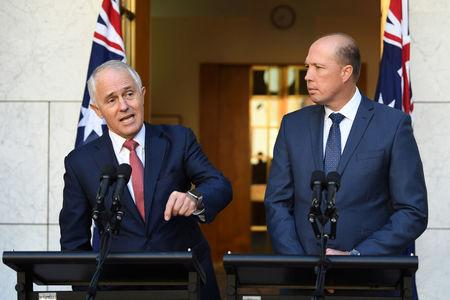 Australian PM Turnbull and Minister for Immigration and Border Protection Dutton speak on Australia's citizenship test during a press conference at Parliament House in Canberra