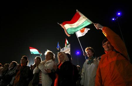 Supporters of ruling Fidesz party wait for the preliminary results of parliamentary elections in Budapest