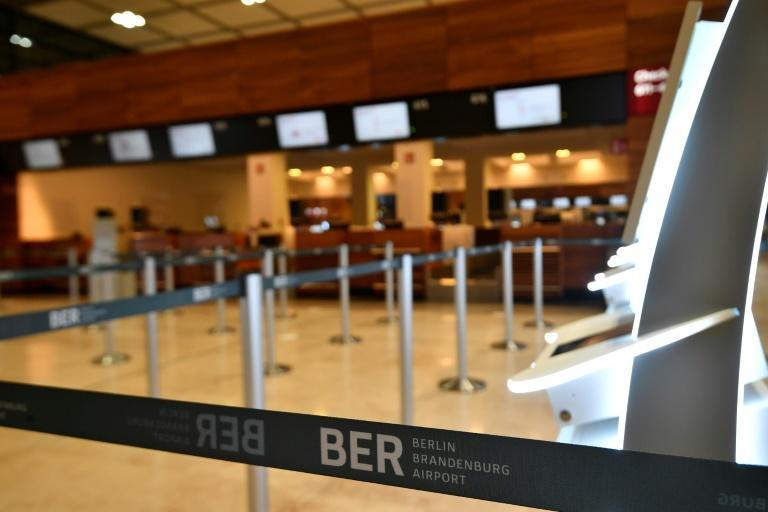 Before the madding crowds -- the check-in area at Terminal 1 of Berlin's airport gets ready for action