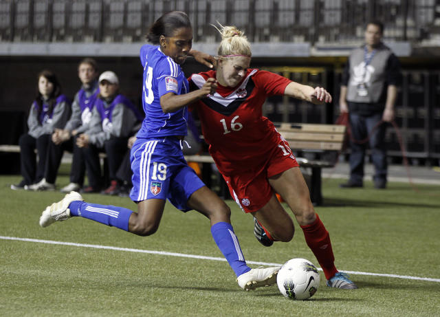 VANCOUVER, CANADA - JANUARY 19: Lauren Sesselmann #16 of Canada collides with Nadia Valentin #19 of Haiti during the 2012 CONCACAF Women's Olympic Qualifying Tournament at BC Place on January 19, 2012 in Vancouver, British Columbia, Canada. (Photo by Jeff Vinnick/Getty Images)