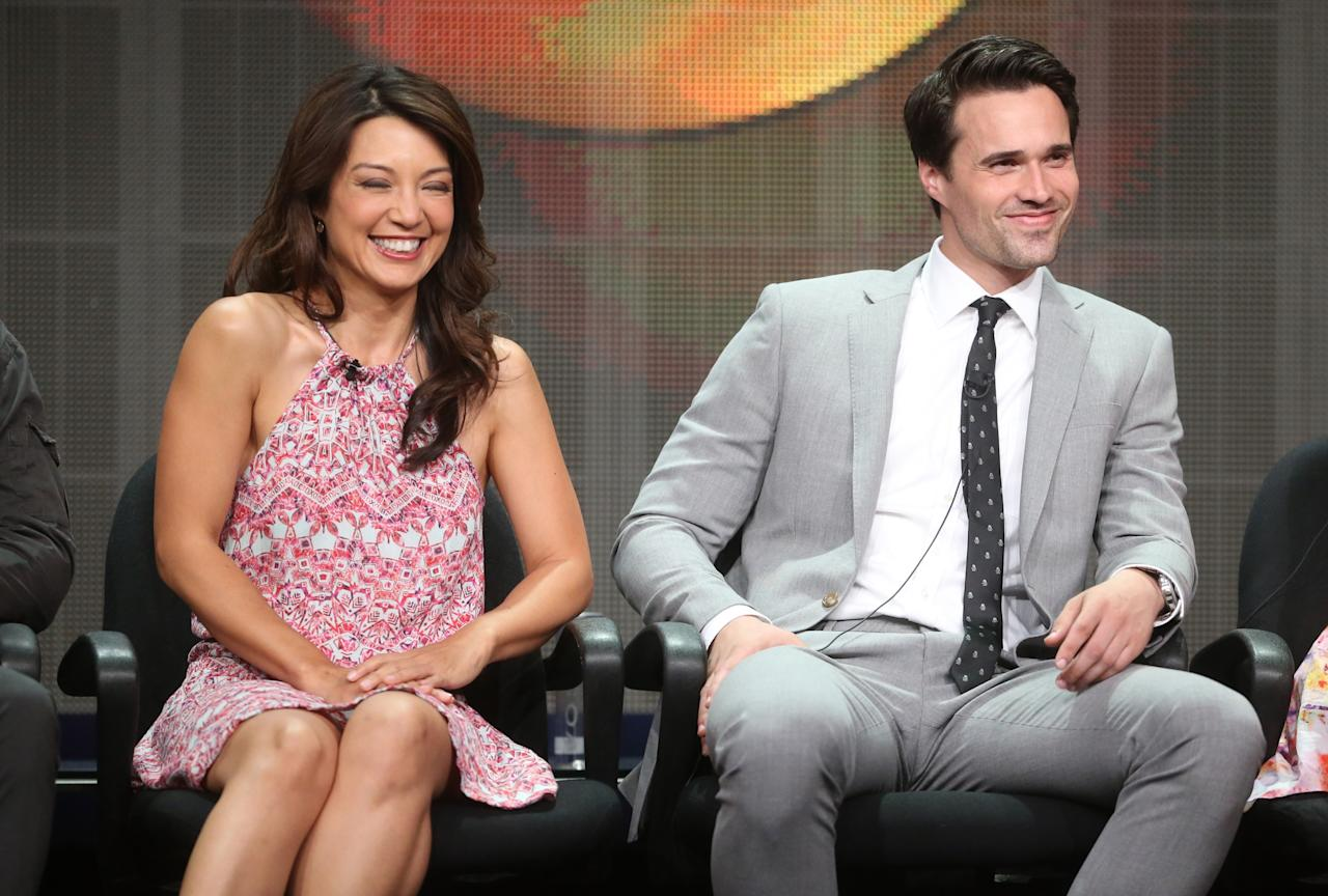 "BEVERLY HILLS, CA - AUGUST 04: Actors Ming-Na Wen (L) and Brett Dalton speak onstage during the ""Agents of S.H.I.E.L.D."" panel discussion at the Disney/ABC Television Group portion of the Television Critics Association Summer Press Tour at the Beverly Hilton Hotel on August 4, 2013 in Beverly Hills, California. (Photo by Frederick M. Brown/Getty Images)"