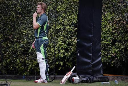 Australia's Shane Watson takes a break from batting in the nets during a team training session at the Sydney Cricket Ground January 2, 2014. Australia are hoping to achieve a 5-0 sweep over England in the Ashes series when the fifth test match starts on Friday. REUTERS/David Gray