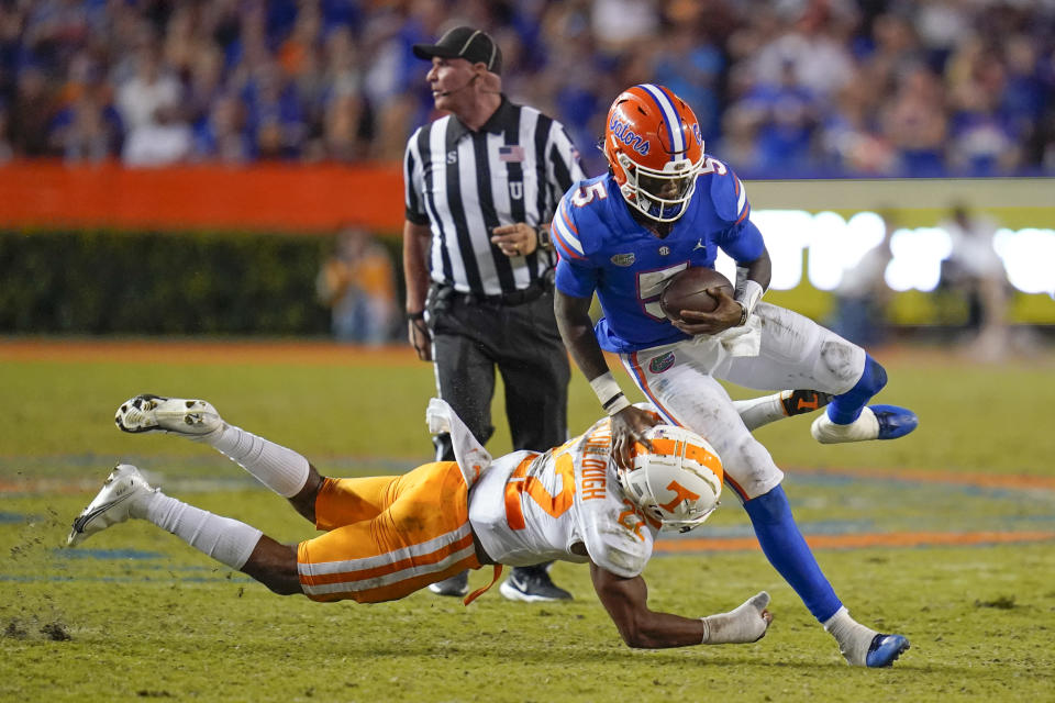 Florida quarterback Emory Jones (5) tries to get past Tennessee defensive back Jaylen McCollough, left, during the second half of an NCAA college football game, Saturday, Sept. 25, 2021, in Gainesville, Fla. (AP Photo/John Raoux)