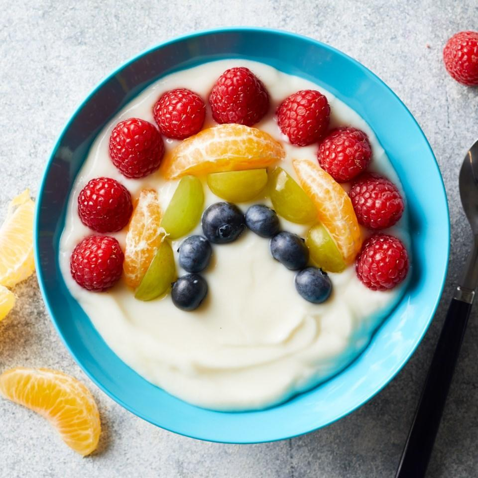 <p>Arrange vibrant, colorful fruit in the shape of a rainbow on top of yogurt for a fun and delicious healthy breakfast or snack kids will actually want to eat.</p>