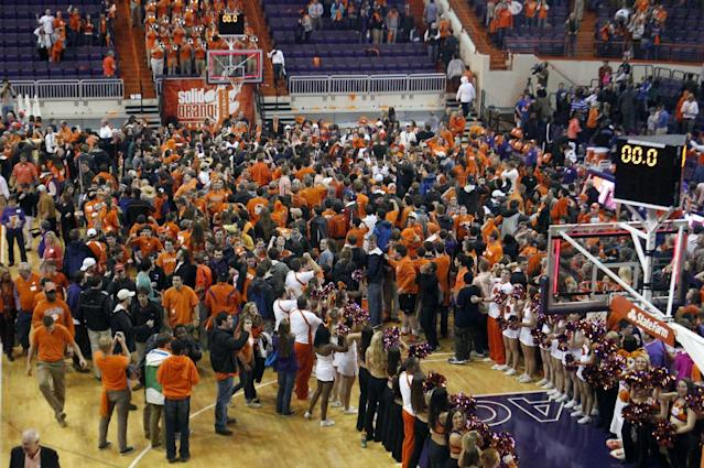 Clemson fans celebrate after an NCAA college basketball game against Duke in Clemson, S.C., on Saturday, Jan. 11, 2014. (AP Photo/The Independent-Mail, Sefton Ipock)