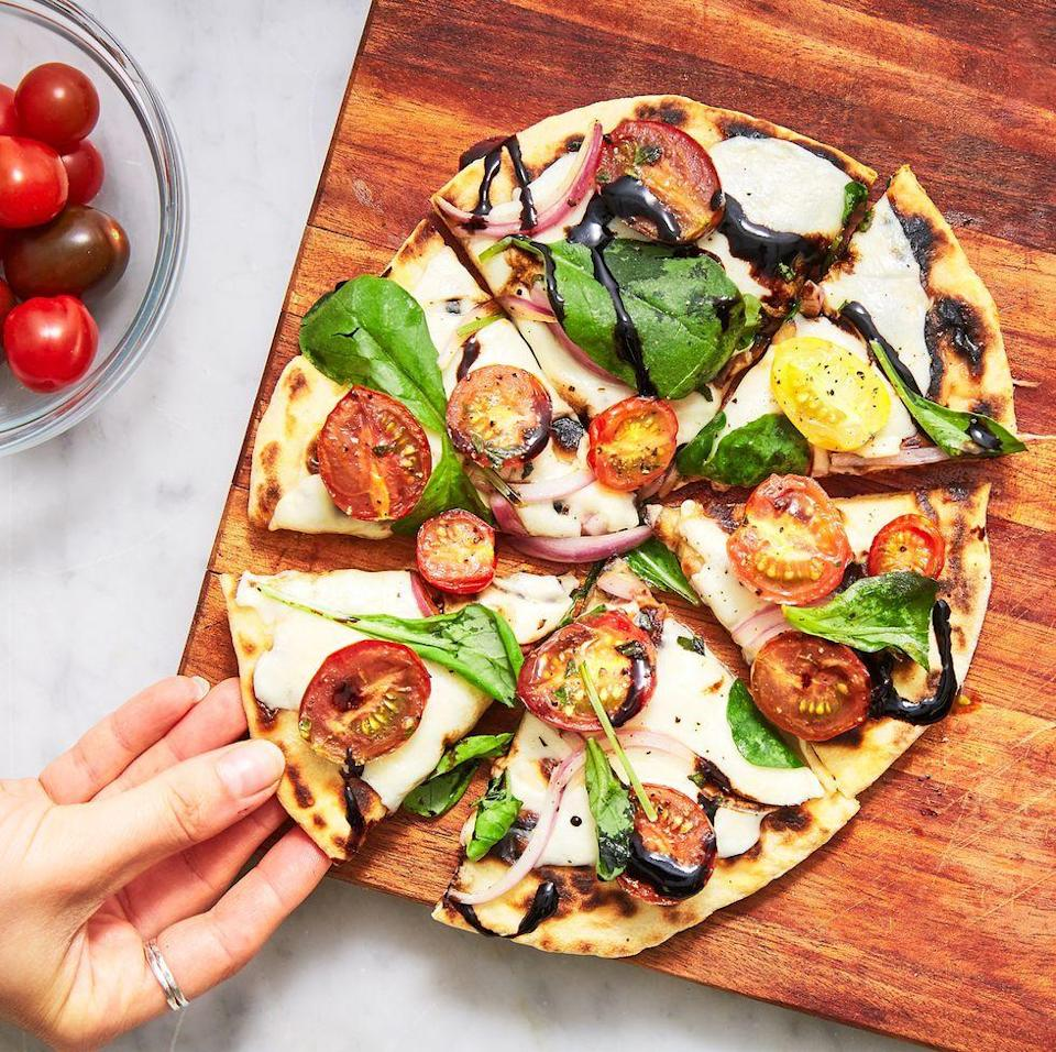 """<p>Homemade <a href=""""https://www.delish.com/uk/cooking/recipes/a30100767/chicken-crust-jalapeno-popper-pizza-recipe/"""" rel=""""nofollow noopener"""" target=""""_blank"""" data-ylk=""""slk:pizza"""" class=""""link rapid-noclick-resp"""">pizza</a> is super-delicious, but it takes a bit of time and special attention. These flatbread pizzas come together MUCH faster, and they're just as cheesy and flavourful as the classic version. </p><p>Get the <a href=""""https://www.delish.com/uk/cooking/recipes/a30621093/easy-flatbread-pizza-recipe/"""" rel=""""nofollow noopener"""" target=""""_blank"""" data-ylk=""""slk:Flatbread Pizza"""" class=""""link rapid-noclick-resp"""">Flatbread Pizza</a> recipe.</p>"""