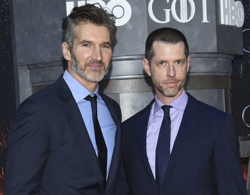 "FILE - In this Wednesday, April 3, 2019, file photo, creator/executive producers David Benioff, left, and D. B. Weiss attend HBO's ""Game of Thrones"" final season premiere at Radio City Music Hall in New York. Walt Disney Co. CEO Bob Iger said Tuesday, May 14, 2019, that ""Game of Thrones"" showrunners Benioff and Weiss are working on the new ""Star Wars"" film expected in theaters in December 2022. (Photo by Evan Agostini/Invision/AP, File)"