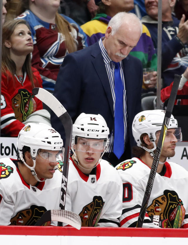 FILE - In this March 30, 2018, file photo, Chicago Blackhawks head coach Joel Quenneville, back, looks down after his team gave up a power-play goal against the Colorado Avalanche inthe second period of an NHL hockey game in Denver. The Blackhawks have fired three-time Stanley Cup winning coach Joel Quenneville on Tuesday, Nov. 6, 2018.(AP Photo/David Zalubowski, File)