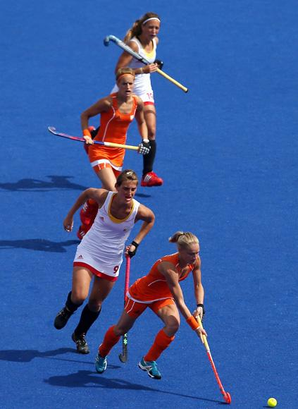 Maartje Goderie of Netherlands competes with Lieselotte Van Lindt of Belgium during the Women's Pool WA Match W02 between the Netherlands and Belgium at the Hockey Centre on July 29, 2012 in London, England. (Photo by Daniel Berehulak/Getty Images)