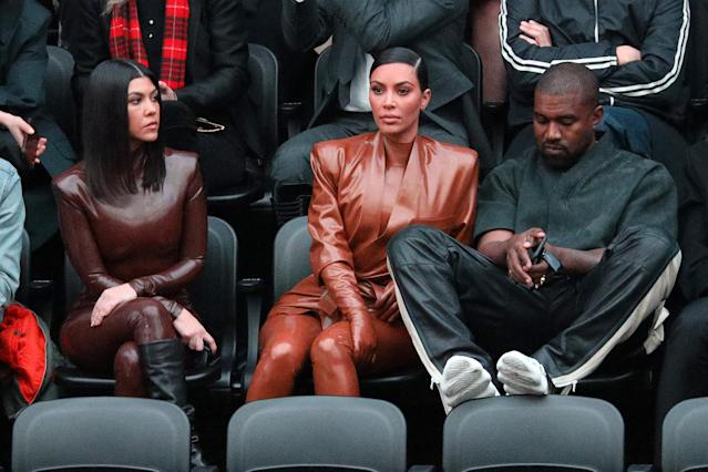 PARIS, FRANCE - MARCH 01: (EDITORIAL USE ONLY) Kourtney Kardashian,Kim Kardashian and Kanye West attend the Balenciaga show as part of the Paris Fashion Week Womenswear Fall/Winter 2020/2021 on March 01, 2020 in Paris, France. (Photo by Pierre Suu/Getty Images)