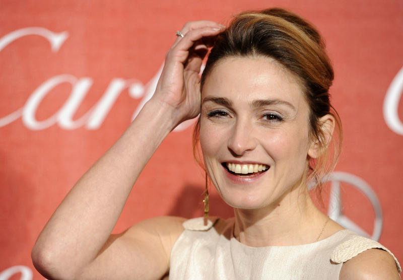 FILE - In this Jan.7, 2012 file photo, French actress Julie Gayet poses at the 2012 Palm Springs International Film Festival Awards Gala, in Palm Springs, Calif. French President Francois Hollande is threatening legal action over magazine report saying on Friday Jan.10, 2014 that he is having a secret affair with the French actress. Rumors have long circulated that Hollande might have a lover. The magazine Closer published images Friday showing his bodyguard and a helmeted man it says is Hollande visiting what it says is the apartment of the actress. (AP Photo/Chris Pizzello, File)