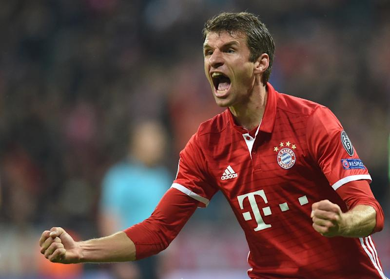 Bayern Munich's striker Thomas Mueller celebrates after the first goal during the UEFA Champions League group D football match FC Bayern Munich vs PSV Eindhoven in Munich, on October 19, 2016