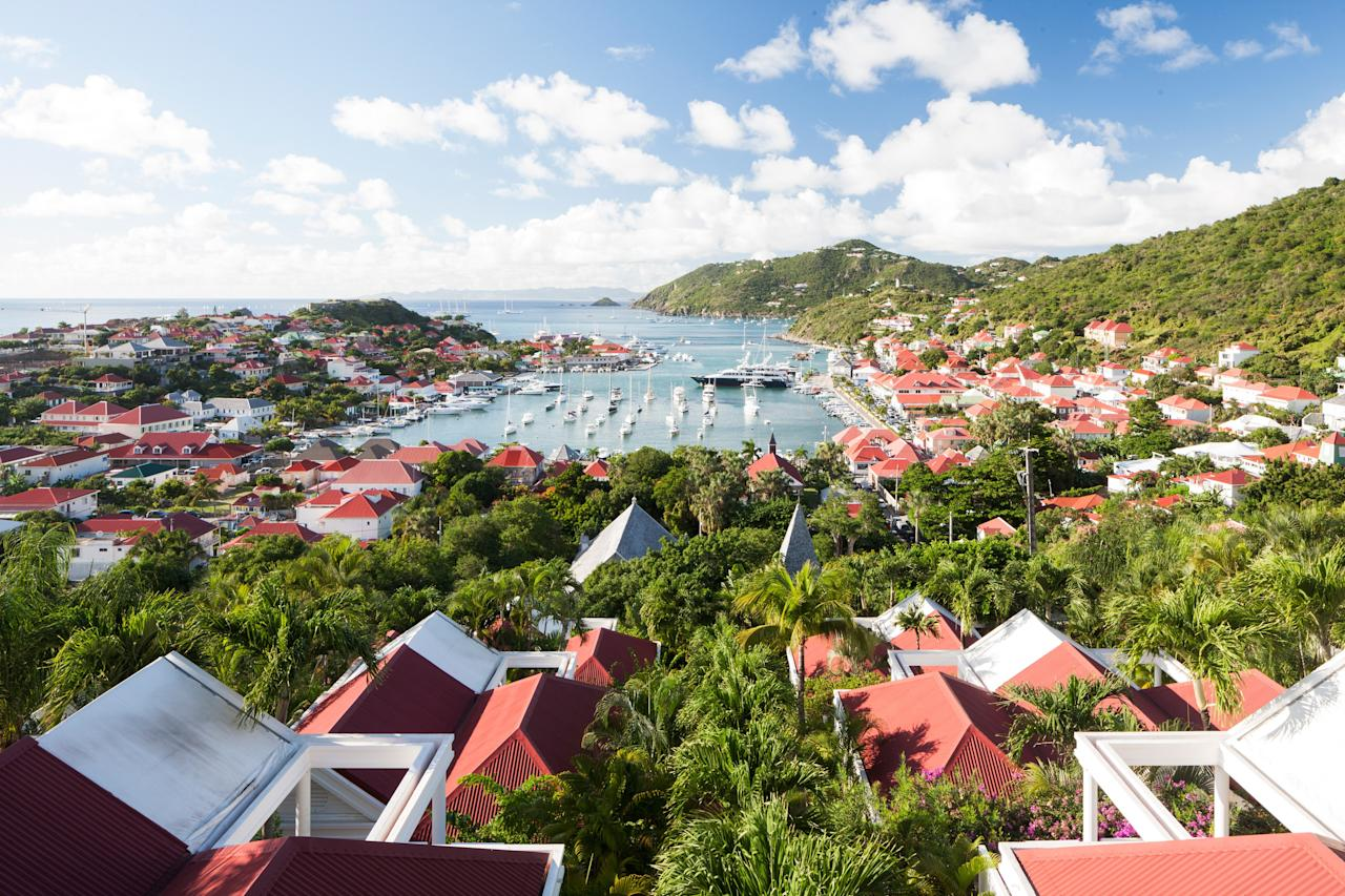 """It was two years ago when tiny, tony <a href=""""https://www.cntraveler.com/story/the-perfect-long-weekend-in-st-barts?mbid=synd_yahoo_rss"""">St. Barts</a> felt the full force of two devastating hurricanes in quick succession. Yet by December 2019, it has almost fully rebounded, with two of the island's most beloved luxury boltholes reopening at last. The beachfront 37-room Eden Rock is officially welcoming guests again, as is the 23-room <a href=""""https://www.cntraveler.com/story/the-hottest-new-hotel-openings-this-fall?mbid=synd_yahoo_rss"""">Hotel Barrière Le Carl Gustaf</a>, set on a hill in the middle of the cobblestoned capital Gustavia. December, of course, is the island's peak season, especially over the last two weeks, when it's packed with celebrities on boats and in villas, prepping to celebrate New Year's Eve at clubs like Shellona Beach or Nikki Beach (there's a regatta every year on December 31 to help showcase those mega yachts). Come on the weekends before Christmas, however, and you can shop the 10th edition of the Magic of Christmas village in Gustavia: expect crafts, snacks and a visit from a sunburnt Santa—or Père Noël, as the locals might say."""