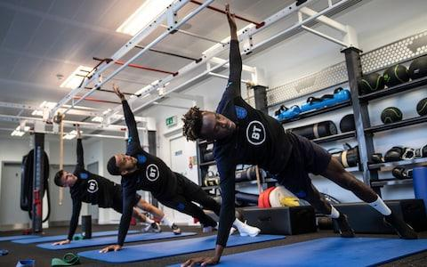 <span>Mason Mount, Callum Wilson and Tammy Abraham work out in the gym at St George's Park</span> <span>Credit: Eddie Keogh for The FA/REX </span>