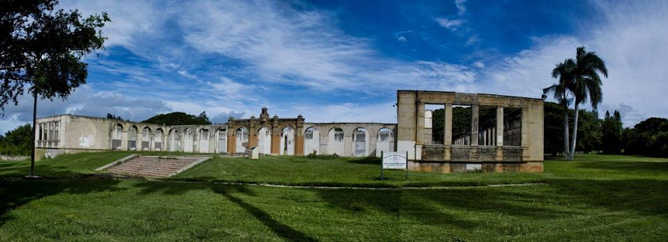 """<p><strong>Old Maui High - Pāʻia, HI</strong></p><p>Opened in 1921, the Maui High School administration and classroom building sat on a beautiful 24-acre campus. However, after a shift in student population, the school relocated to a different campus in 1972–completely abandoning the old building.</p><p>Photo: Flickr/<a href=""""https://www.flickr.com/photos/kirt_edblom/45117552855/in/photolist-2d2ULFA-2bJTfAk-2a1v8RZ-N7o7dS-hrv2Jk-7E1AD7-b7oeNB-28TJrxC-TfzCL5-8maf6q-8m766i-6RJhD-2e2K99a-28rMBNy-8m752p-21ASf5a-6TP8K-76oZS-76p4C-hruXBx-DzVa53-6TP8J-76p4i-DTMk7M-P6pie-8mafhj-dj9Qgr-dj9NXs-dj9QbP"""" rel=""""nofollow noopener"""" target=""""_blank"""" data-ylk=""""slk:Kirt Edblom"""" class=""""link rapid-noclick-resp"""">Kirt Edblom</a></p>"""