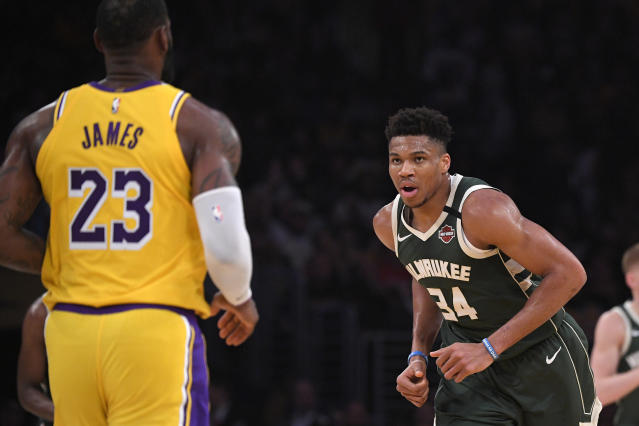 Do the health risks of COVID-19 outweigh the economic and legacy-building rewards of playing for NBA players? (AP Photo/Mark J. Terrill)