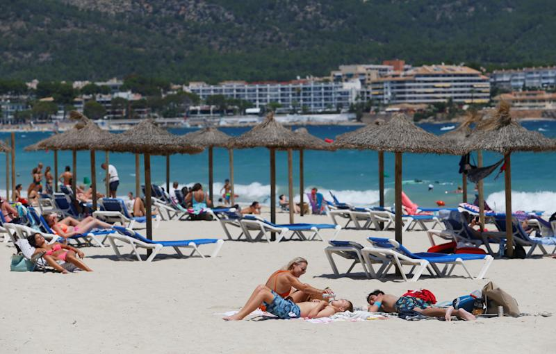 People sunbathe in Magaluf beach, amid the coronavirus disease (COVID-19) outbreak in Palma de Mallorca, Spain July 11, 2020. REUTERS/Enrique Calvo