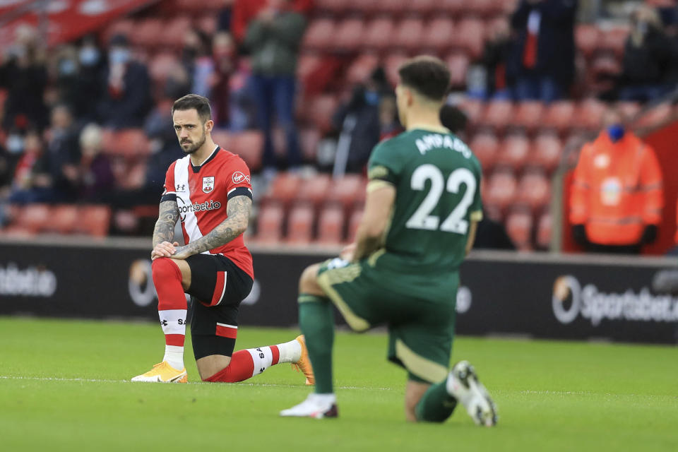 Players take a knee in support of the Black Lives Matter movement before the English Premier League soccer match between Southampton and Sheffield United, at St. Mary's stadium in Southampton, England, Saturday, Dec. 13, 2020. (Adam Davy/Pool via AP, File)