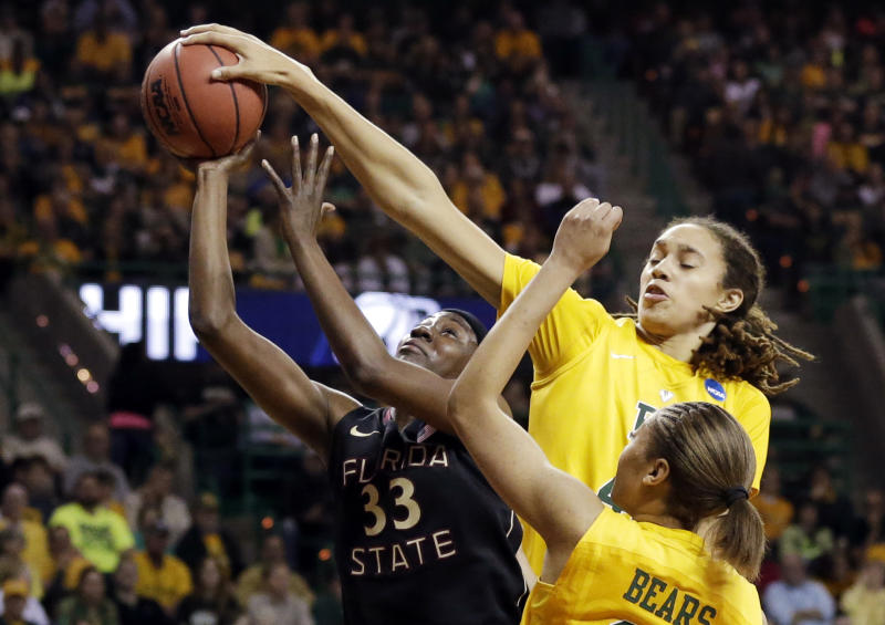 Florida State forward Natasha Howard (33) has her shot blocked by Baylor's Brittney Griner, right rear, as Alexis Prince, bottom, watches in the first half of a second-round game in the women's NCAA college basketball tournament, Tuesday, March 26, 2013, in Waco, Texas. (AP Photo/Tony Gutierrez)