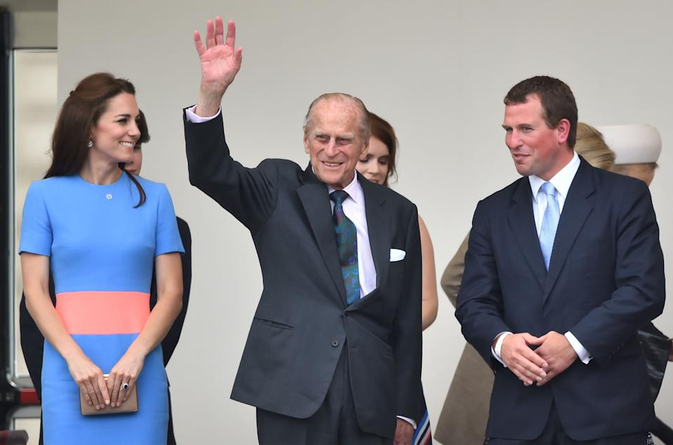 (left to right) The Duchess of Cambridge, the Duke of Edinburgh and Peter Phillips  in the Royal Box for the Patron's Lunch in The Mall, central London, in honour of the Queen's 90th birthday. PRESS ASSOCIATION Photo. Picture date: Sunday June 12, 2016. The Queen's grandson Peter Phillips has masterminded the street party for 10,000 people, to mark the monarch's patronage of more than 600 charities and organisations. See PA story ROYAL Birthday. Photo credit should read: Dominic Lipinski/PA Wire