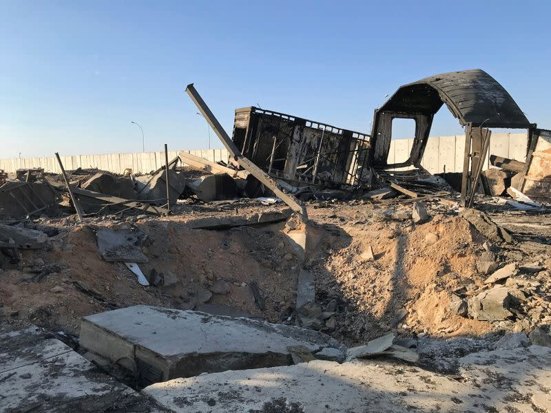 Debris and rubble are seen at the site where an Iranian missile hit at Ain al-Asad air base in Anbar province