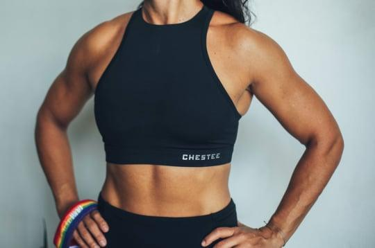 """<p>While any quality sports bra will offer support when running, jumping, or going upside down, the <a href=""""https://www.popsugar.com/buy/Pride-T-Chestee-478074?p_name=Pride%20T%20Chestee&retailer=thechestee.com&pid=478074&price=64&evar1=fit%3Aus&evar9=46445638&list1=workout%20clothes%2Cworkouts%2Ccrossfit&prop13=api&pdata=1"""" rel=""""nofollow"""" data-shoppable-link=""""1"""" target=""""_blank"""" class=""""ga-track"""" data-ga-category=""""Related"""" data-ga-label=""""https://thechestee.com/collections/tops/products/the-pride-t-chestee"""" data-ga-action=""""In-Line Links"""">Pride T Chestee</a> ($64) has extra padding above the breasts to prevent bruising from the barbell (it happens!). </p>"""